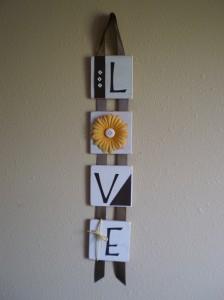 Elm Street Studios' favorite piece in her shop is her LOVE wall hanging.