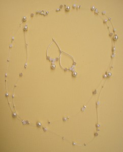 This shows Jessica's necklace and earrings. She also has a matching bracelet in the invisible wire style, with three strands of beads, which is pictured after the jump.