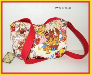This Alice in Wonderland-themed bag is one of Jeanean's favorite from her shop, Tucancreations.